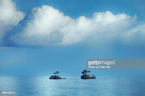twin rock islands with twin trees - collin key stock-fotos und bilder