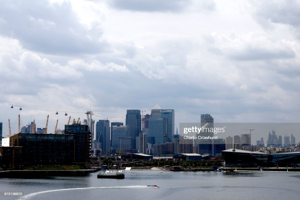 A F1H2O twin seater makes its way down Victoria Dock with the London Docklands City in the background during the World Championship's press conference, ahead of the London Grand Prix, at ExCel on June 13, 2018 in London, England.