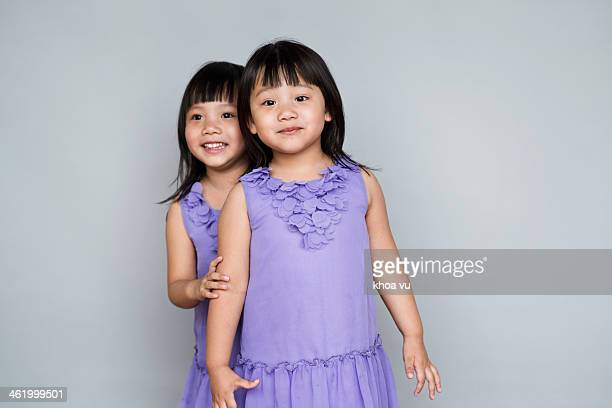 twin sister - asian twins stock photos and pictures