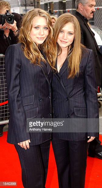 Twin sisters Ashley and MaryKate Olsen arrive at The Avenue May 7 2002 in London to launch their brand of clothes in the United Kingdom