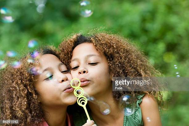 Twin Sisters Blowing Bubbles