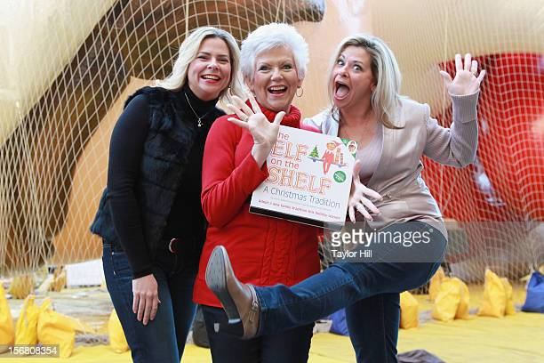 Twin sisters Chanda Bell and Christa Pitts celebrate with their mother 'The Elf on the Shelf' coauthor Carol Aebersold at the inflation of the new...