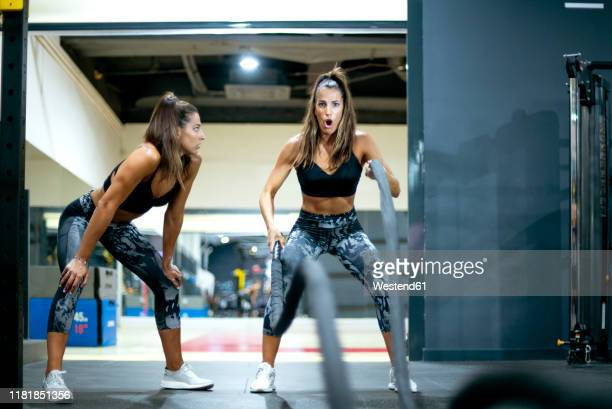 twin sisters in gym practicing with ropes - extra long stock pictures, royalty-free photos & images
