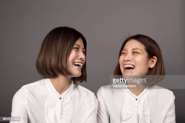 Twin sisters laughing loud