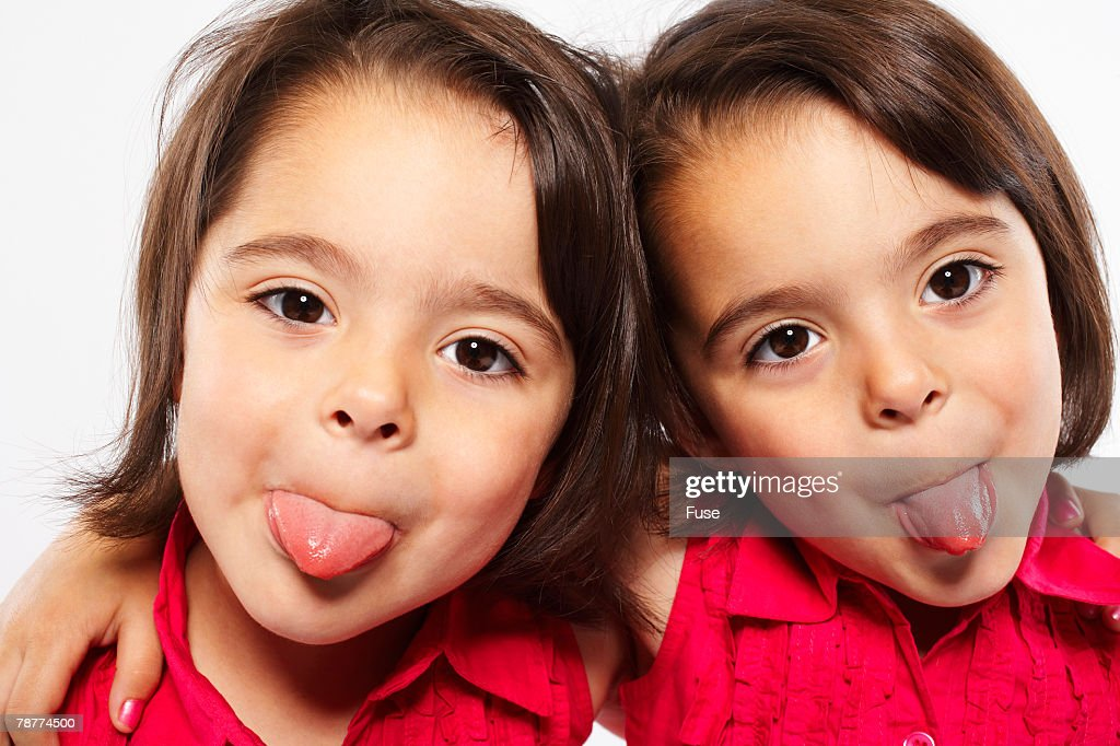 Twin Sisters Making Funny Faces High-Res Stock Photo