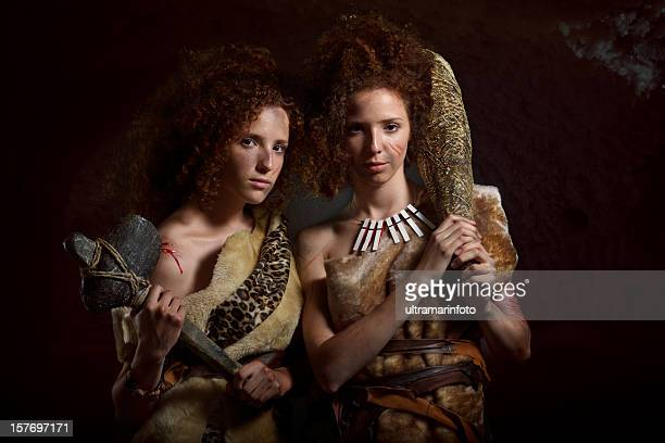 twin sisters - stone age stock photos and pictures