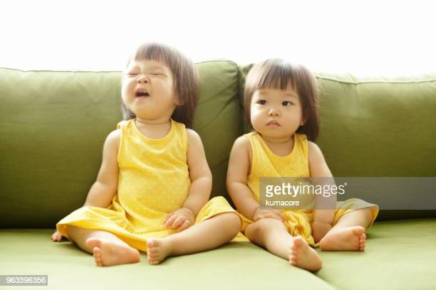 twin sisters - asian twins stock photos and pictures