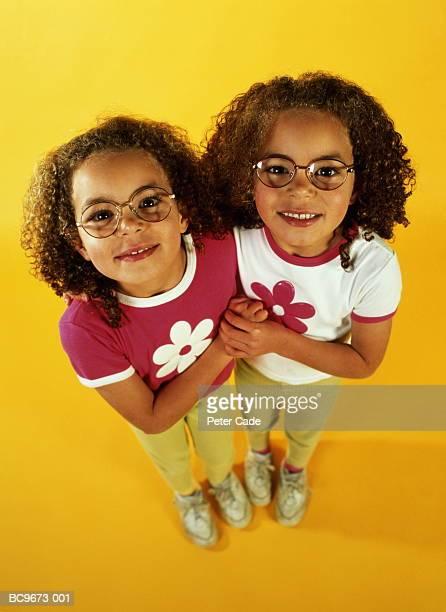 Twin sisters (4-6), portrait