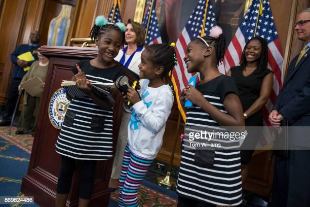 Twin sisters Seilah Tappin left and Shiloh of Bethesda Md talk with friend Dani Hebron during a news conference in the Capitol with House Minority...