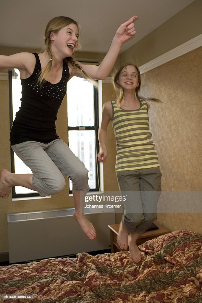 Picture of: Twin Teenage Girls Jumping On Bed In Bedroom High Res Stock Photo Getty Images