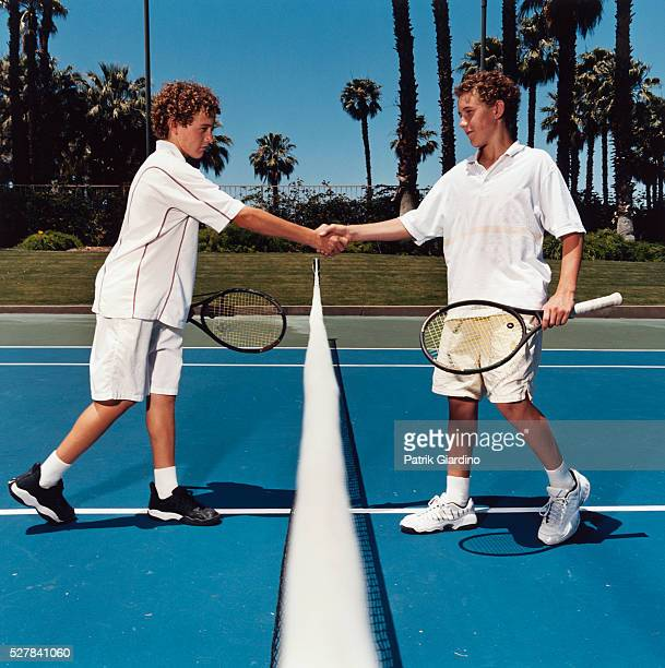 Twin Tennis Players Shaking Hands