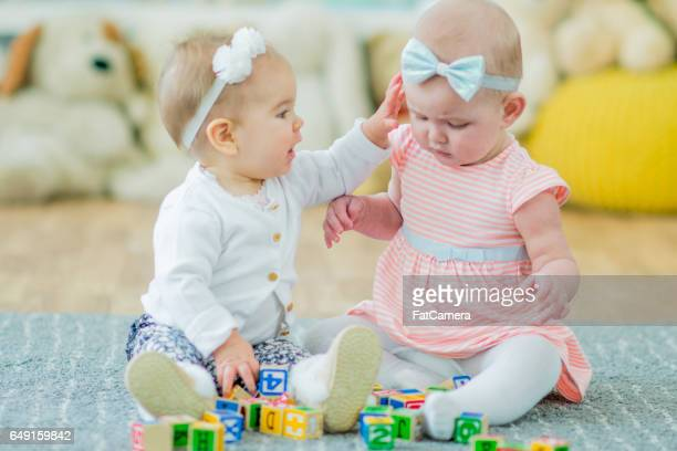 Twin Toddlers Playing Together