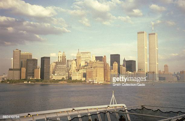 Twin towers of the World Trade Center viewed from the aft deck of the Cunard Line's Queen Elizabeth 2 cruise ship in New York Harbor New York City...