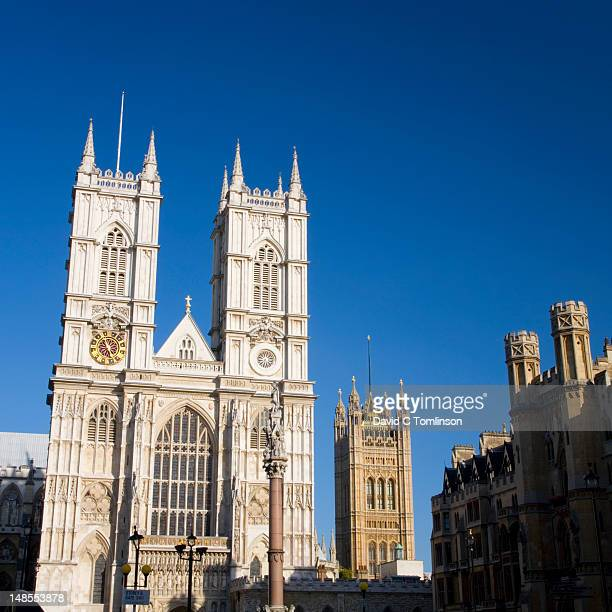 twin towers of westminster abbey and distant victoria tower, highest tower of the houses of parliament. - victoria tower stock pictures, royalty-free photos & images