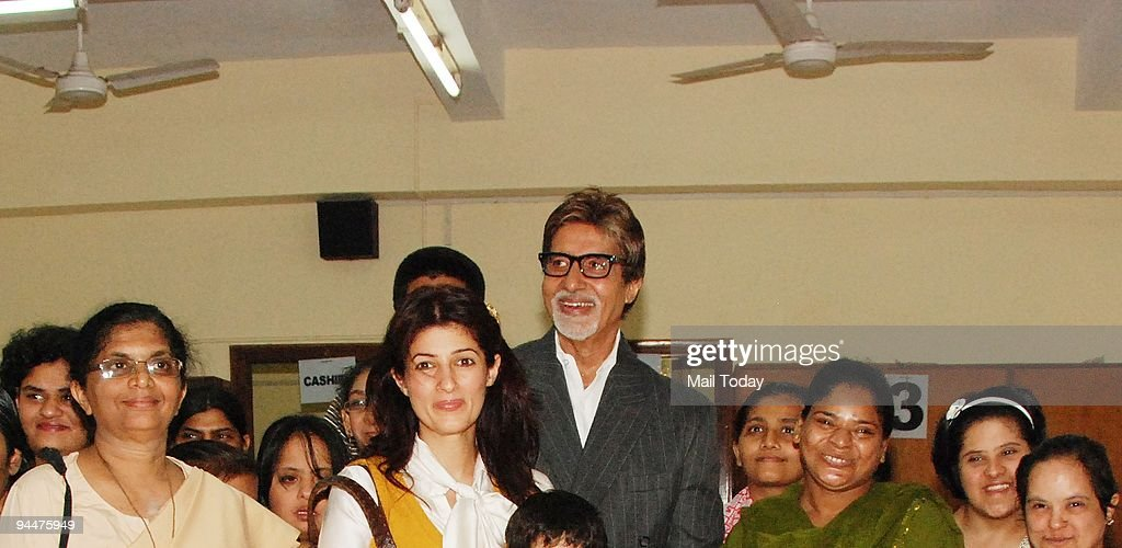 Twinkle Khanna and Amitabh Bachchan with underpriviledged children at a promotional event for the film Paa in Mumbai on Sunday December 13 2009