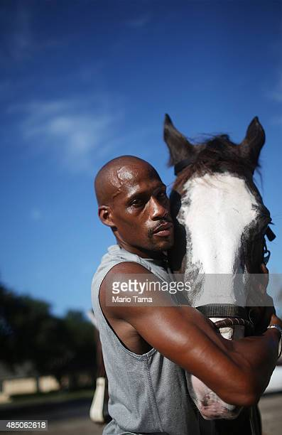 Twinn poses hugging his horse Vision who he said helped him rescue five family members in the Lower Ninth Ward in the aftermath of Hurricane Katrina...