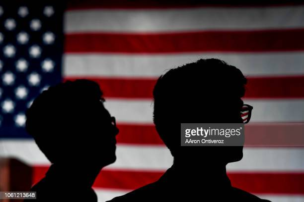 Twins Adam and Adrian Gomez watch results on the television during the Democratic watch party in downtown Denver on Tuesday November 6 2018 Democrat...