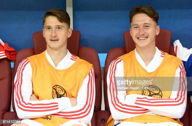 Twins Alexey Miranchuk of Russia and Anton Miranchuk look on from the bench prior to the 2018 FIFA World Cup Russia Group A match between Russia and...