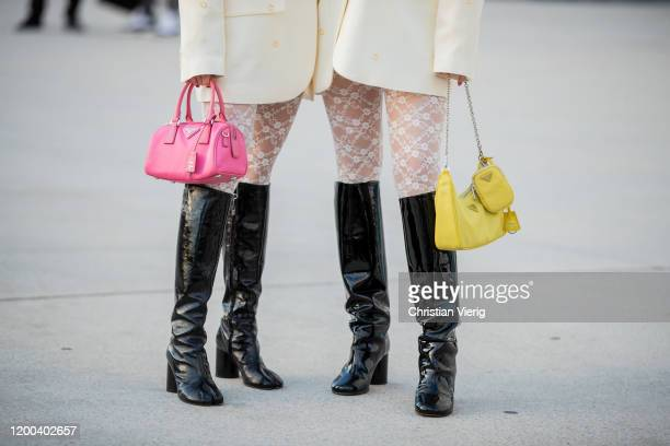 Twins Ami Amiaya and Aya Amiaya seen wearing yellow turtleneck creme white blazer tights with print pink and yellow Prada bag black boots outside...