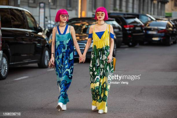 Twins Ami Amiaya and Aya Amiaya wearing blue and yellow dress with print and bag seen outside Ferragamo during Milan Fashion Week Fall/Winter...