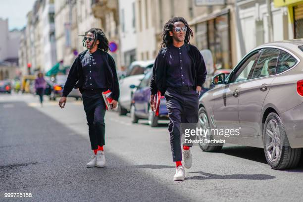 Twins are seen outside Wooyoungmi during Paris Fashion Week Menswear SpringSummer 2019 on June 23 2018 in Paris France