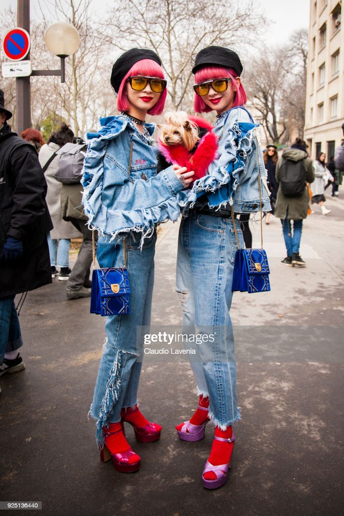 Twins Aya Amiaya, Little Lola Sunshine and Ami Amiaya wear denim tailleur, Dior blue bag and black hat in the streets of Paris before the Dior show during Paris Fashion Week Womenswear Fall/Winter 2018/2019 on February 27, 2018 in Paris, France.