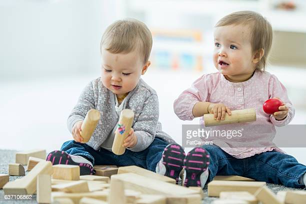 Twins Babies Playing Happily