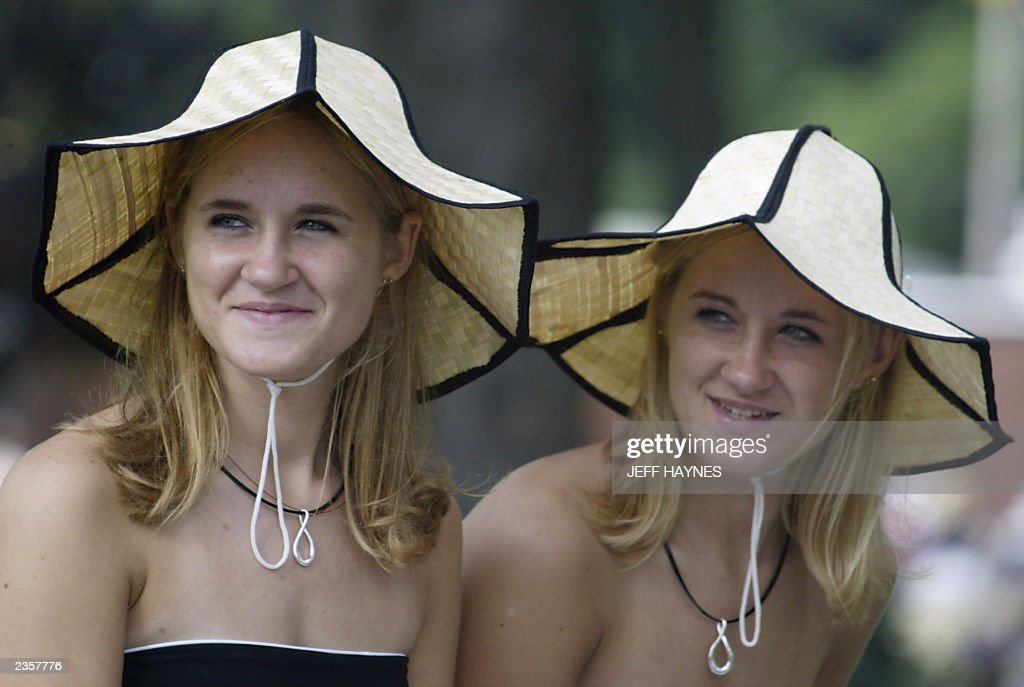 Twins Besty (L) and Jessica (R) McDonald wait before the 28th Twins Day Festival parade 02 August, 2003 in Twinsburg, Ohio. The event, billed as the 'Largest Annual Gathering of Twins in the World,' is the only festival where twins worldwide gather to celebrate being of multiple birth. AFP PHOTO/Jeff HAYNES