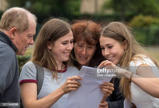 Twins Catherine and Gemma King who both obtained 5 A* grades open their A Level exam results with their parents at Lady Eleanor Holles school on...