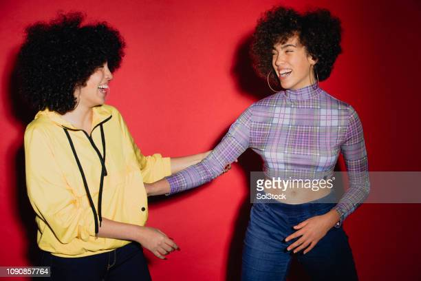 twins dancing together - identical twin stock pictures, royalty-free photos & images