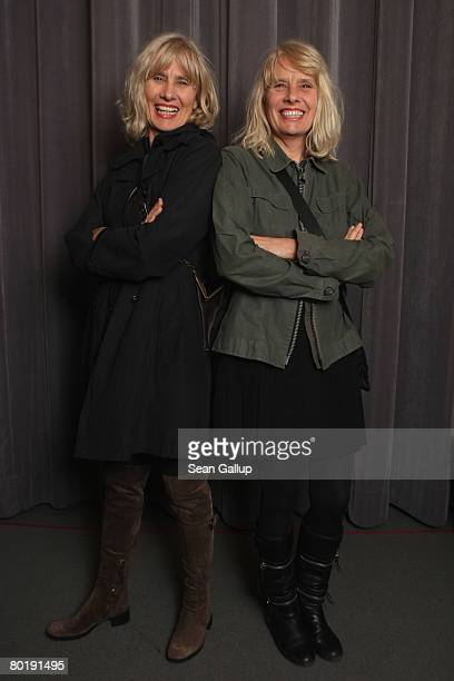 Twins Gisela Getty and Jutta Winkelmann pose for a photograph before a reading from their new book Twins at the Babylon movie theatre on March 10...