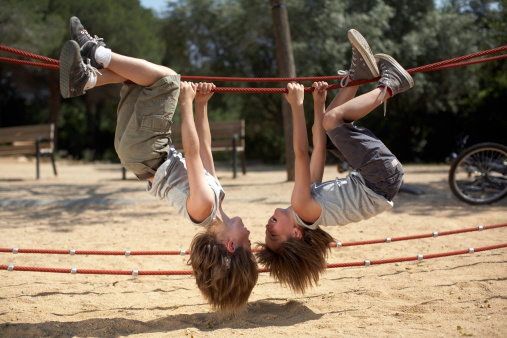 twins hang from structure in park - gettyimageskorea