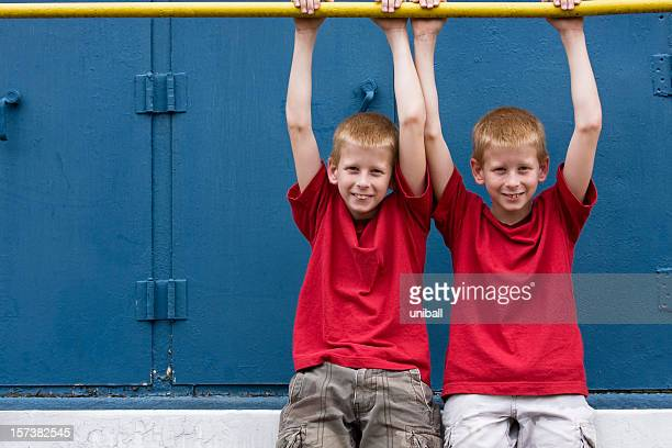 twins hanging around - identical twin stock pictures, royalty-free photos & images