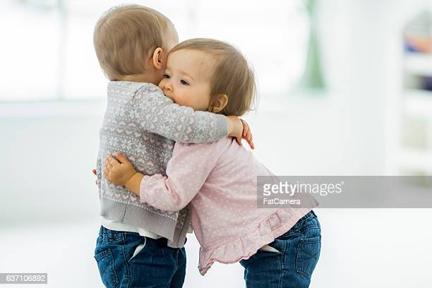 twins hugging - preschool stock pictures, royalty-free photos & images