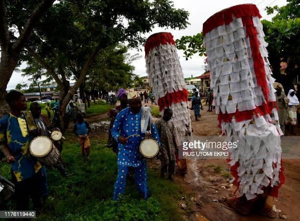 Twins Igunuko masquerades dance to drumming as they arrive to attend IgboOra World Twins festival to celebrate the uniqueness in multiple births at...