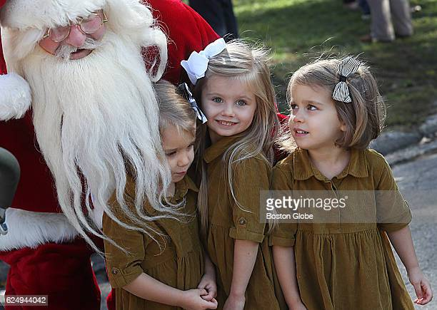 Twins Jane Jensen and Clara Jensen and big sister Tillie Rose Jensen take a picture with Santa Claus who was on hand for the arrival of the annual...