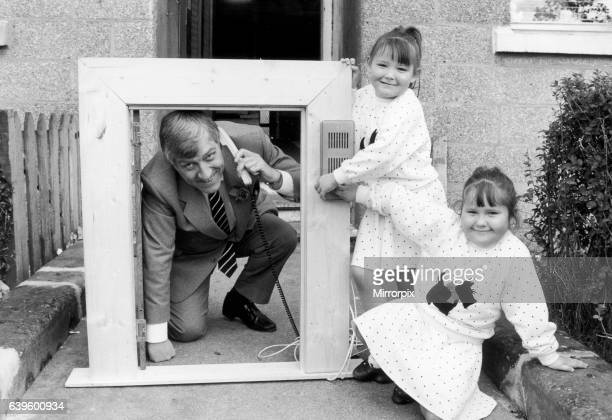 Twins Laura and Lesley Cunningham join Govan's fight against crime as they show Bob Gillespie a new door secutiry system 31st October 1988