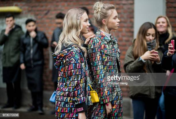 Twins Lisa Mantler and Lena Mantler seen outside Fendi during Milan Fashion Week Fall/Winter 2018/19 on February 22 2018 in Milan Italy