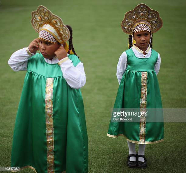 Twins Lucy and Sophie Ama stand in traditional Russian dress during a sound check at Sochi Park on July 27 2012 in London England The Russia...