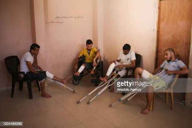 Twins Muhammed and Ahmed Diyab Bilal and Said Diyab are seen with crutches and a wheelchair after Israeli forces opened fire on them and...