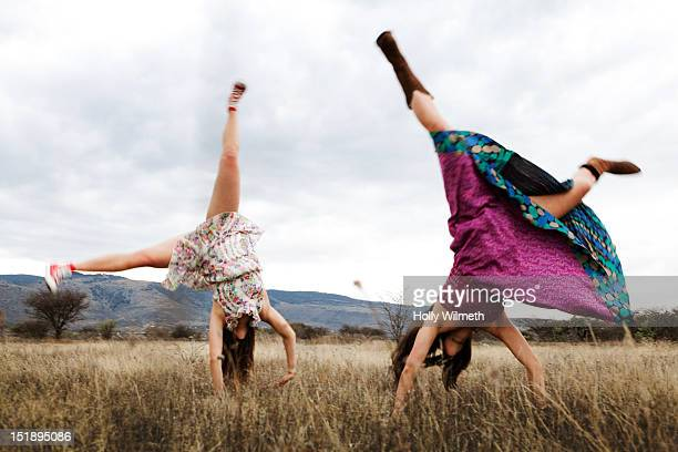 twins - cartwheel stock pictures, royalty-free photos & images