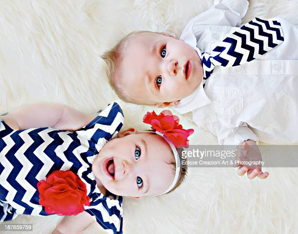 twins - cute twins stock photos and pictures