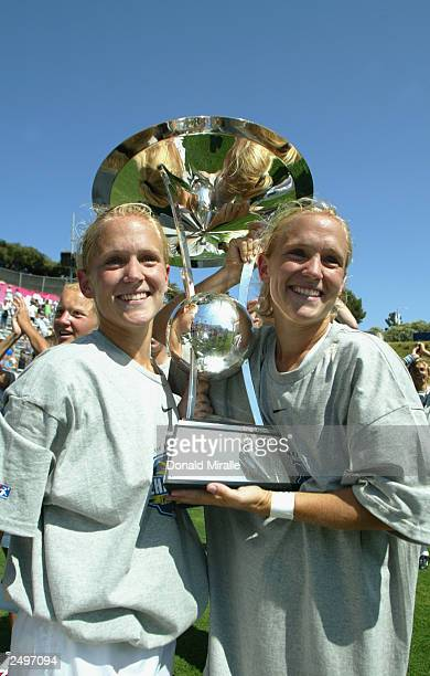 Twins Skylar Little and Jacqui Little of the Washington Freedom hold the Founders Cup after the victory over the Atlanta Beat in the Founders Cup...