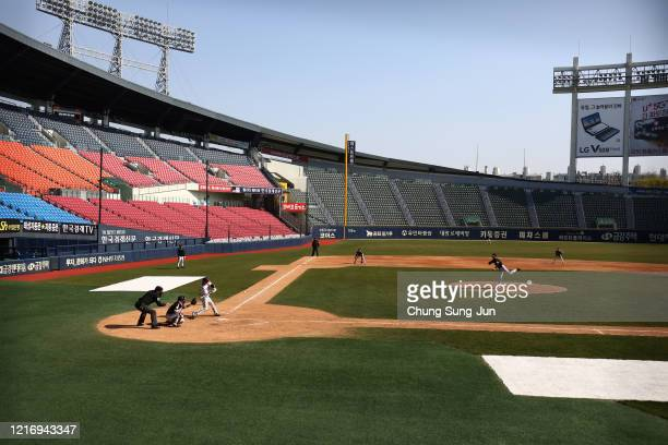 LG Twins team players play their intrateam game broadcasted online for their fans at a empty Jamshil baseball stadium as South Koreans take measures...