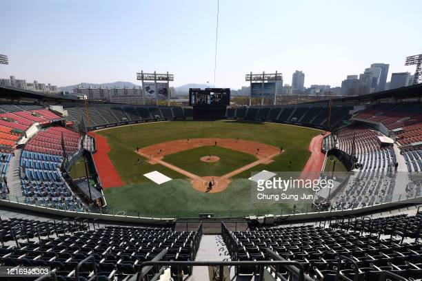 LG Twins team players play their intrateam game to be broadcasted online for their fans at a empty Jamshil baseball stadium as South Koreans take...