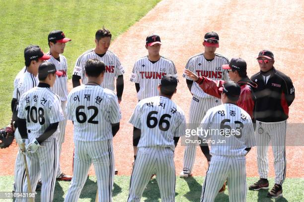 LG Twins team players practice ahead of their intrateam game to be broadcasted online for their fans at a empty Jamshil baseball stadium as South...