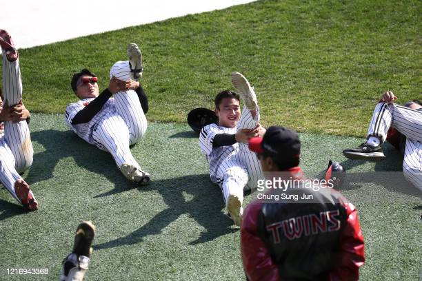 LG Twins team players stretch ahead of their intrateam game to be broadcasted online for their fans at a empty Jamshil baseball stadium as South...