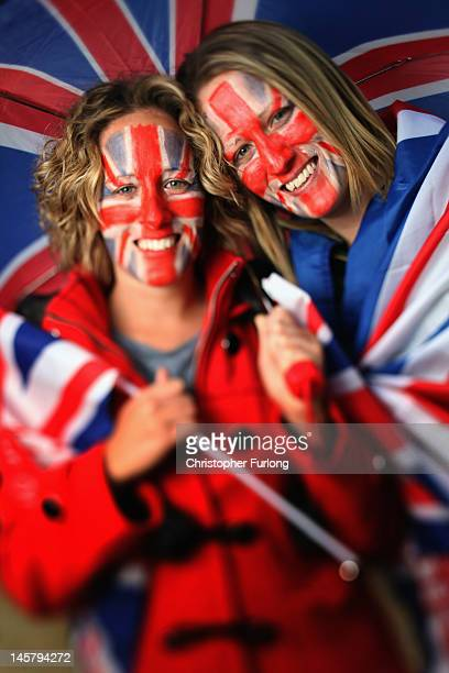 Twins Victoria and Rebecca Groom, of canary Wharf, London pose on the The Mall as thousands gather for The Diamond Jubilee Concert on June 4, 2012 in...