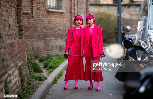 Twins with pink hair Ami Amiaya and Aya Amiaya wearing red blazer and dress seen outside Ferragamo on Day 4 Milan Fashion Week Autumn/Winter 2019/20...