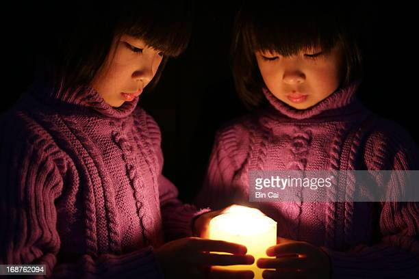 twins with the light - candle of hope stock pictures, royalty-free photos & images